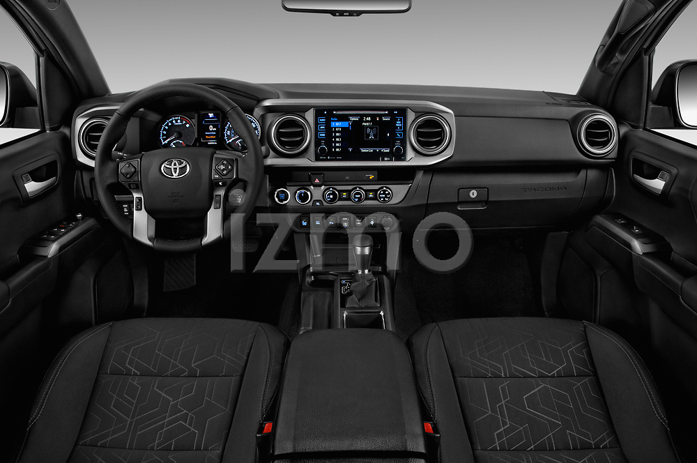 Stock photo of straight dashboard view of a 2018 Toyota Tacoma TRD Off Road Double Cab 4 Door Pick Up