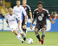 Clyde Simms #19 of D.C. United passes away from Geovanni #77 of the San Jose Earthquakes during an MLS match at RFK Stadium in Washington D.C. on October 9 2010. San Jose won 2-0.