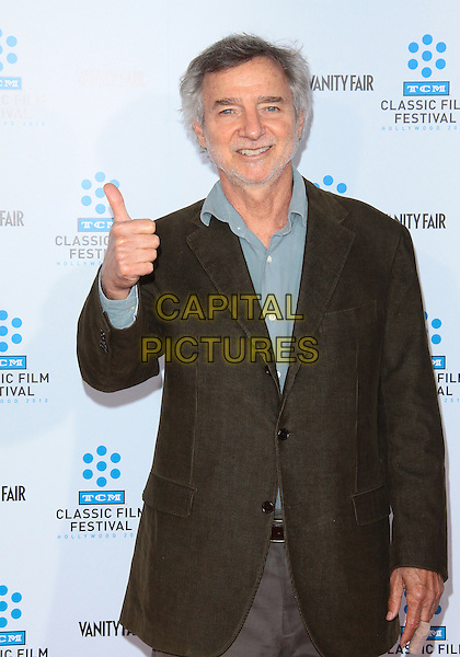 "CURTIS HANSON .TCM Classic Film Festival - ""A Star Is Born"" - Arrivals held at Grauman's Chinese Theatre, Hollywood, California, USA, 22nd April 2010..half length thumb up grey gray shirt black jacket .CAP/ADM/TC.©T. Conrad/AdMedia/Capital Pictures."