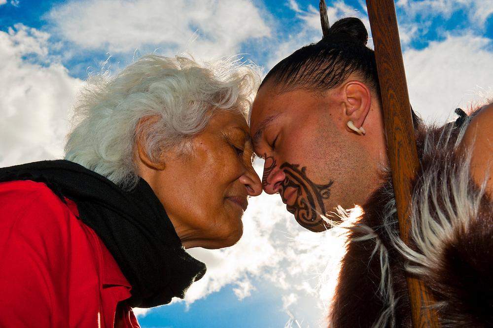 Maori Greeting Hongi: A Maori Man With Ta Moko (facial Tattoo) And An Elderly
