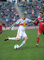 New York defender Markus Holgersson (5) plays the ball in front of Chicago midfielder Chris Rolfe (17).  The Chicago Fire defeated the New York Red Bulls 3-1 at Toyota Park in Bridgeview, IL on April 7, 2013.
