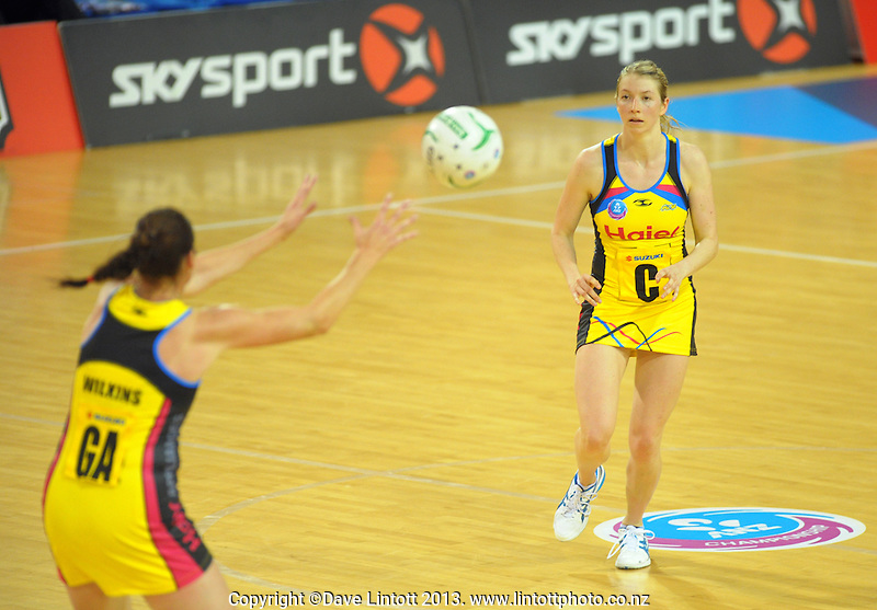 Camilla Lees (right) passes to Donna Wilkins during the ANZ Netball Championship match between Central Pulse and Firebirds at Te Rauparaha Arena, Porirua, New Zealand on Monday, 1 April 2013. Photo: Dave Lintott / lintottphoto.co.nz