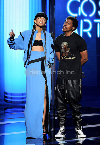 LOS ANGELES, CA - JUNE 29 : (L-R) Zendaya and Nick Cannon present the Best Gospel Artist award onstage at the BET Awards '14 at Nokia Theatre L.A. Live on June 29, 2014 in Los Angeles, California. Credit: PGMicelotta/MediaPunch