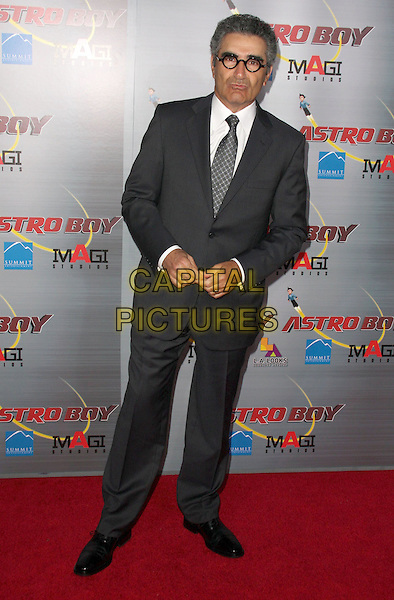 "EUGENE LEVY .""Astro Boy"" Premiere held at the Mann Chinese Theatre, Hollywood, California, USA, 19th October 2009..full length glasses round frames grey gray tie suit white shirt pinstripe black .CAP/ADM/CH.©Charles Harris/AdMedia/Capital Pictures"