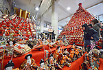 """February 17, 2013, Konosu, Japan - Visitors take a closer look at Girls' Fewstival ornamental dolls displayed on the red-carpeted platform in a huge pyramid shape at the lobby of Konosu city hall, north of Tokyo, on Sunday, February 17, 2013. The dolls numbered 18,000 represent emperor, empress, attendants and musicians in the ancient Imperial court. The city of Konosu, situated some 40 km north of Tokyo, is known as """" the doll town"""" for a number of factories manufacturing Japanese dolls. Japanese tradition calls upon families with daughters for putting out dolls for the Girls Day on March 3 with the hopes that they grow up healthy and happily. (Photo by Natsuki Sakai/AFLO) AYF -mis-."""