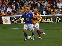 Leon Osman being pressured by Nicky Law in the Motherwell v Everton friendly match at Fir Park, Motherwell on 21.7.12 for Steven Hammell's Testimonial.