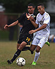Will Taffe #18 of Syosset, right, and Mirdan Padilla #19 of Uniondale battle for possession during a Nassau County Conference AA-1 varsity boys soccer game at Uniondale High School on Tuesday, Oct. 2, 2018. Taffe scored a goal in the second half. Syosset won by a score of 2-0.