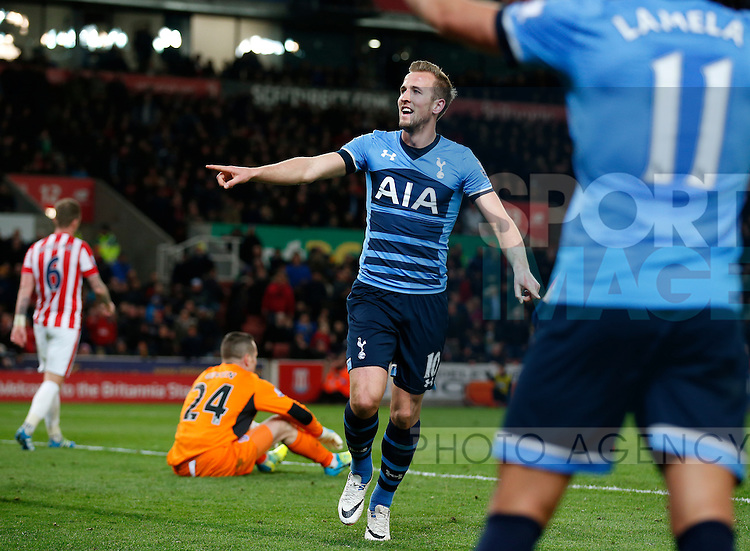 Harry Kane of Tottenham celebrates scoring the third goal during the Barclays Premier League match at The Britannia Stadium. Photo credit should read: Simon Bellis/Sportimage
