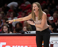 COLLEGE PARK, MD - DECEMBER 28: Kim Barnes Arico Michigan head coach yells out instructions. during a game between University of Michigan and University of Maryland at Xfinity Center on December 28, 2019 in College Park, Maryland.