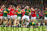 Kerry and Cork players tussle off the ball during the first half of the Munster Final at Fitzgerald Stadium, Killarney on Saturday evening.