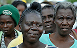 Lucien Joseph, 44, and other women line up to receive packages of food and other emergency supplies from the Lutheran World Federation, a member of the ACT Alliance, in the village of Gressier outside of Port-au-Prince, Haiti. A January 12 earthquake ravaged the Caribbean nation, leaving hundreds of thousands hungry and increasingly frustrated and desperate.