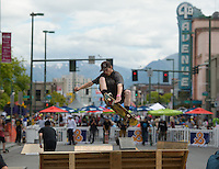 Daniel Redmon catches air on the quarter pipe in the Solstice <br /> Skate Jam during the 2016 Downtown Summer Solstice Festival in downtown Anchorage.
