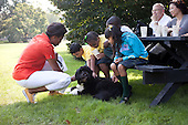 First Lady Michelle Obama and kids from Tubman Elementary School in Washington, D.C., pet Bo, the Obama family dog, on the South Lawn of the White House, September 14, 2011..Mandatory Credit: Samantha Appleton - White House via CNP