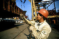 Worker at Guangzhou shipyard, Guangzhou, China.