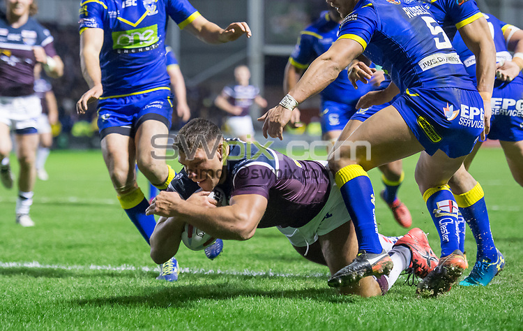 Picture by Allan McKenzie/SWpix.com - 01/02/2018 - Rugby League - Betfred Super League - Warrington Wolves v Leeds Rhinos - Halliwell Jones Stadium, Warrington, England - Leeds's Ryan Hall dives over to score a try against Warrington.