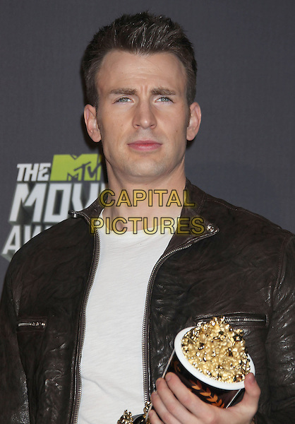 Chris Evans.2013 MTV Movie Awards held at Sony Pictures Studios, Culver City, California, USA..April 14th, 2013.press room pressroom headshot portrait white top black leather jacket award trophy winner  .CAP/ADM/RE.© Russ Elliot/AdMedia/Capital Pictures