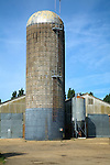 Tower silos grass storage silo in farm yard, Wickham Market, Suffolk, England