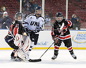 Florence Schelling (NU - 41), ?, Kelly Wallace (NU - 5) - The University of New Hampshire Wildcats defeated the Northeastern University Huskies 5-3 (EN) on Friday, January 8, 2010, at Fenway Park in Boston, Massachusetts as part of the Sun Life Frozen Fenway doubleheader.