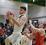 SPEARFISH, SD: DECEMBER 30:  Antonio Capley #35 of Black Hills State grabs a rebound in front of Mika Nuolivirta #40 of CSU Pueblo during their game Saturday evening at the Donald E. Young Center in Spearfish, S.D.   (Photo by Dick Carlson/Inertia