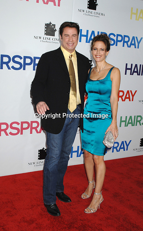 "John Travolta and wife Kelly Preston..arriving at the New York Premiere of ""Hairspray"" on         July 16, 2007 at The Ziegfeld Theatre. ..Robin Platzer, Twin Images......212-935-0770"