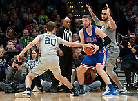 WASHINGTON, DC - DECEMBER 28: George Muresan #20 of Georgetown clashes with Mark Gasperini #23 of American as Omer Yurtseven #44 of Georgetown defends. during a game between American University and Georgetown University at Capital One Arena on December 28, 2019 in Washington, DC.