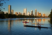 Water sports are a favorite pastime as kayakers and canoers paddle on Lake Austin with the majestic Austin Skyline Sunset in the background
