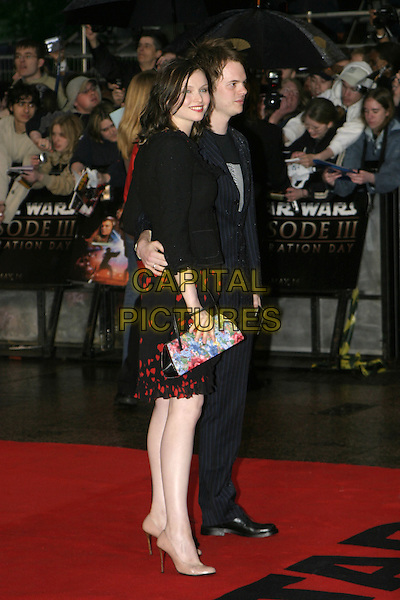 "SOPHIE ELLIS BEXTOR & RICHARD JONES.Arrivals at ""Star Wars Episode III: Revenge of the Sith"" UK Premiere, Odeon Cinema Leicester Square, London,.May 16th 2005..full length couple flower floral print clutch bag.Ref: AH.www.capitalpictures.com.sales@capitalpictures.com.©Adam Houghton/Capital Pictures."