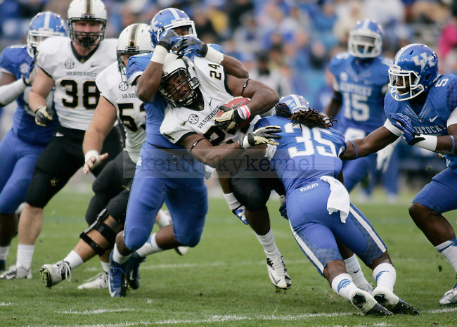 Vanderbilt wide receiver/running back Wesley Tate is tackled by in Commonwealth Stadium during Vanderbilt's 40-0 win over Kentucky Saturday November 3, 2012. Photo by Scott Hannigan