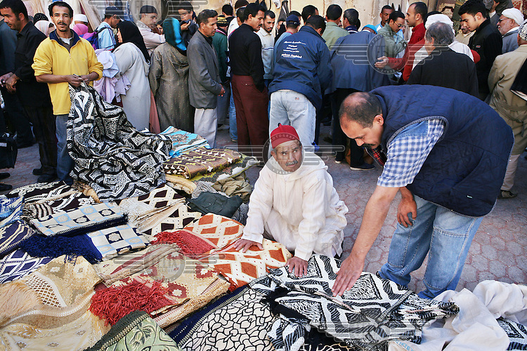 Market selling modern carpets in Fes el Bali (Old Fes), the larger of Fes's two medinas. It is classified as a UNESCO World Heritage Site and is the largest car-free urban area in the world.