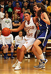 SIOUX FALLS, SD - FEBRUARY 28:  Haleigh Gunn #31 from Roosevelt drives against Katie Messler #40 from O'Gorman in the first half of their District 1AA Championship Game Thursday night at Roosevelt. (Photo by Dave Eggen/Inertia)