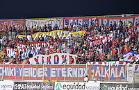 BOGOTÁ -COLOMBIA, 07-08-2015. Hinchas de Independiente Medellin corean a su equipo durante el encuentro entre La Equidad e Independiente Medellín por la fecha 5 de la Liga Águila II 2015 jugado en el estadio Metropolitano de Techo de la ciudad de Bogotá./ Fans of Independiente Medellin cheer their team during the match between La Equidad and Independiente Medellin for the 5th date of the Aguila League II 2015 played at Metropolitano de Techo stadium in Bogotá city. Photo: VizzorImage/ Gabriel Aponte / Staff