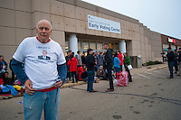 Van driver Dan Girves waits outside a Columbus, Ohio, early voting center for the  college students he transported to the center on the first day of early voting in the state..