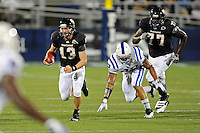 1 October 2011:  FIU quarterback Wesley Carroll (13) carries the ball in the second quarter as the Duke University Blue Devils defeated the FIU Golden Panthers, 31-27, at FIU Stadium in Miami, Florida.