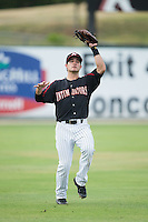 Kannapolis Intimidators shortstop Eddy Alvarez (1) catches a fly ball in shallow left field during the game against the West Virginia Power at Intimidators Stadium on July 2, 2015 in Kannapolis, North Carolina.  The Power defeated the Intimidators 5-1.  (Brian Westerholt/Four Seam Images)