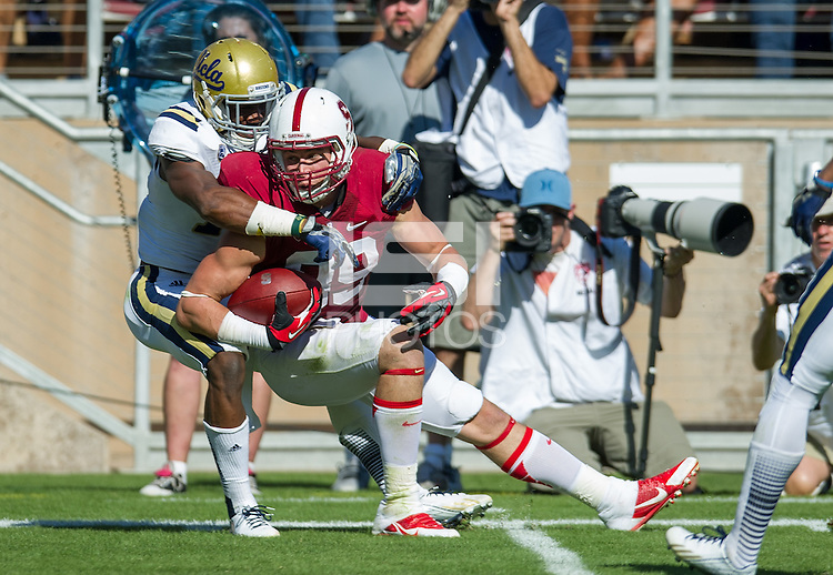 STANFORD, CA - October 19, 2013:  Stanford tight end Devon Cajuste (89) fights for yardage after the catch during the Stanford Cardinal vs the UCLA Bruins at Stanford Stadium in Stanford, CA. Final score Stanford Cardinal 24, UCLA Bruins  10.