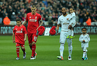 (L-R) Liverpool and Swansea captains Martin Skrtel of Liverpool and Ashley Williams of Swansea City carry a wreath in tribute to the 96 dead of the Hillsborough disaster towards the away fans before the Barclays Premier League match between Swansea City and Liverpool at the Liberty Stadium, Swansea on Sunday May 1st 2016