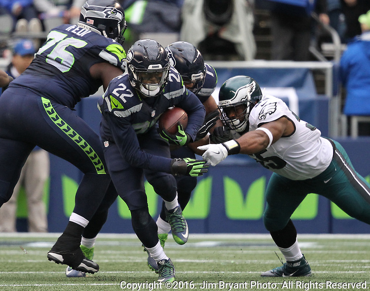 Seattle Seahawks running back C.J. Prosise (22) runs through the attempted tackle of Philadelphia Eagles defensive end Brandon Graham (55) at CenturyLink Field in Seattle, Washington on November 20, 2016.  Seahawks beat the Eagles 26-15.  ©2016. Jim Bryant Photo. All Rights Reserved.