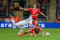 Gareth Bale of Wales falls under a challenge from Giorgi Navalovski of Georgia during the FIFA World Cup Qualifier match between Wales and Georgia at the Cardiff City Stadium, Cardiff, Wales on 9 October 2016. Photo by Mark  Hawkins / PRiME Media Images.