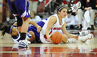 Badger senior Rae Lin D'Alie sits down with Wildcats ' Kristin Cartwright, as Wisconsin loses to Northwestern 68-62 on Sunday, 1/31/10, at the Kohl Center in Madison, Wisconsin