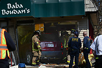 NWA Democrat-Gazette/ANDY SHUPE<br /> Emergency personnel work Friday, March 22, 2019, to stabilize the structure of the Baba Boudan's building at 701 N. College Ave. in Fayetteville after a car struck the building.