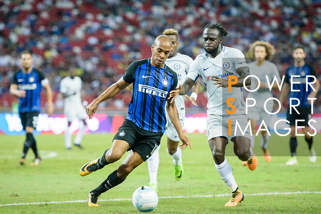 FC Internazionale Midfielder Joao Mario (L) fights for the ball with Chelsea Midfielder Victor Moses (R) during the International Champions Cup 2017 match between FC Internazionale and Chelsea FC on July 29, 2017 in Singapore. Photo by Weixiang Lim / Power Sport Images