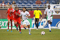 Guadeloupe midfielder Stephane Auvray (18) dribbles the ball past Panama midfielder Gabriel Gómez (6) during the CONCACAF soccer match between Panama and Guadeloupe at Ford Field Detroit, Michigan.