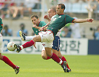 USA's Earnie Stewart tries to keep Joahan Rodriguez from the ball. The USA defeated Mexico 2-0 in the Round of 16 of the FIFA World Cup 2002 in South Korea on June 17, 2002.