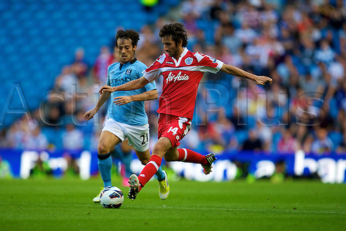 01.09.2012 Manchester, England. Queens Park Rangers Estaban Granero and Manchester City's Spanish midfielder David Silva in action during the Premier League game between Manchester City and QPR from Eastlands.