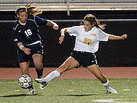 DOYLESTOWN, PA - OCTOBER 6: Council Rock South's Jesse Magee #16 and Central Bucks West's Allie Walsh #25 fight for the ball in the first half at Central Bucks West October 6, 2014 in Doylestown, Pennsylvania. (Photo by William Thomas Cain/Cain Images)