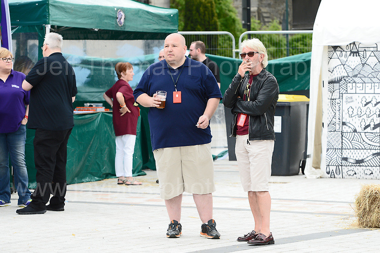 Visitors at the event. On the left is organiser Lyn Williams during the Merthyr Rising Festival 2016 in Merthyr Tydfil on Saturday June 4th and Sunday June 5th 2016. <br /> <br /> <br /> Jeff Thomas Photography -  www.jaypics.photoshelter.com - <br /> e-mail swansea1001@hotmail.co.uk -<br /> Mob: 07837 386244 -