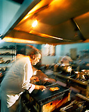 Brazil, Belem, South America, chef preparing food in kitchen
