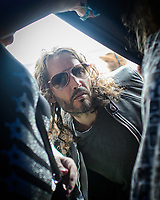 Russel Brand gets in the back of a tent where he was due for a talk for a crowd at the Wilderness Festival in Oxfordshire, August 6, 2017. <br /> CAP/CAM<br /> &copy;Andre Camara/Capital Pictures