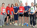 Gary O'Hanlon from Clonliffe Warriors (1st), Ronnie Maxwell (2nd), Paul McQuillan (3rd), Maria Kiernan of Drogheda and District (1st L), Yasmin Canning Drogheda and District (2ndL) and Kana Akimoto (3rdL) are presented with their trophies from Lorraine balfe of Integral Fitness at the Clogherhead 10k run. Photo: Colin Bell/pressphotos.ie