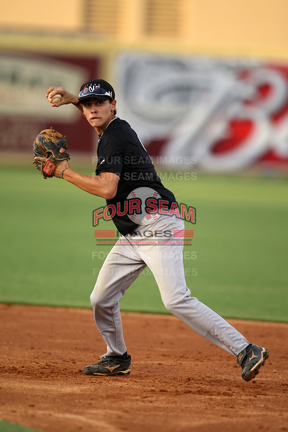 Third Baseman/Shortstop Christian Arce-Toledo of Orangewood Christian High School participates in the Team One Futures Game East at Roger Dean Stadium in Jupiter, Florida September 25, 2010..  Photo By Mike Janes/Four Seam Images